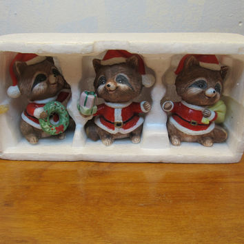 SET OF THREE RETIRED HOMCO HOLIDAY RACCOON FIGURINES