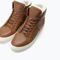 Lined leather high-top sneaker