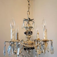 Distressed crystal chandelier lighting heavily weathered rusty ceiling fixture blue cream embellished pearls roses decor anita spero design