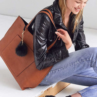 Reversible Vegan Leather Pompom Tote Bag | Urban Outfitters