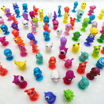 100Pcs/lot Plastic Monster Sucker Dolls kids Animal Cupule Suckers Action Figure Toy Suction Cup Collector Capsule Model Puppets