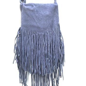 This crossbody bag features a faux suede flap with long fringe around the edge, layered fringe around the bottom edge detailing, and adjustable crossbody strap. An interior front-wall pocket and solid fabric lining and finish with back zip pocket. Crossbod
