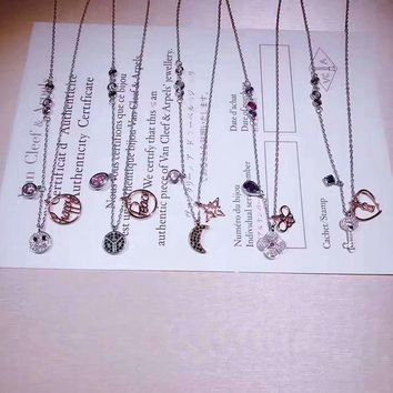 ONETOW SWAROVSKI Delicate and smiling face, love key, star moon, flower butterfly, peace symbol Peaced elegant necklace