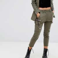 Religion Cargo Pants With Metallic Details at asos.com
