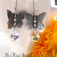 Sterling Silver butterfly charms and small clear swarvoski crystal earrings.