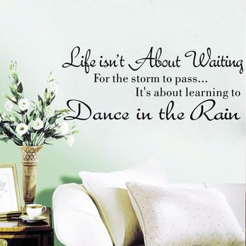 Life isn't about waiting for the storm to pass, it's about learning to dance in the rain wall decal