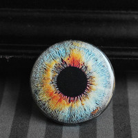Eyeball pinback button - pale blue/orange eye
