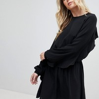 Ivyrevel Mini Skater Dress with Open Back and Frill detail at asos.com
