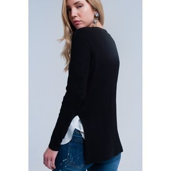 Black sweater with white shirt