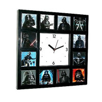 Faces of Darth Vader Star Wars Clock with 12 images some with Light Sabre