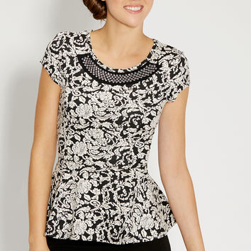 peplum top in floral print with embellished neckline