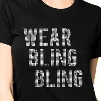 Rhinestones. Wear Bling Bling shirt.