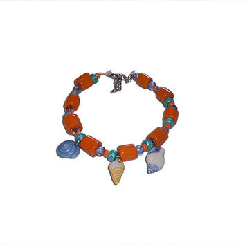 Orange and Teal Plastic and Glass Shell Charm Bracelet