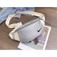 Nike x Puma x Adidas Joint Hot Selling Male and Female Pure Fashion Luggage Crossing the Breast White NIKE