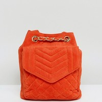 Glamorous Quilted Velvet Backpack in Burnt Orange at asos.com
