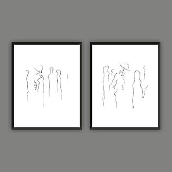 Two minimalist art prints. Set for gallery wall. A man and a woman in the crowd. Black and white modern drawings.
