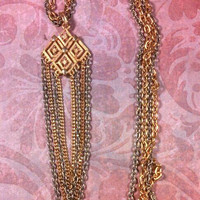 Funky silver and gold tassle long necklace. Very 70s.