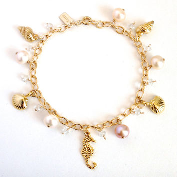 Gold Beach Bracelet. Clamshells, Conch shells, Seahorse, Pearls and Topaz Beach wedding bracelet.