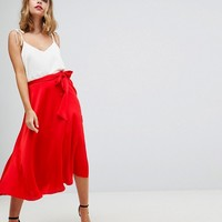 ASOS DESIGN Petite satin midi skirt with self belt at asos.com