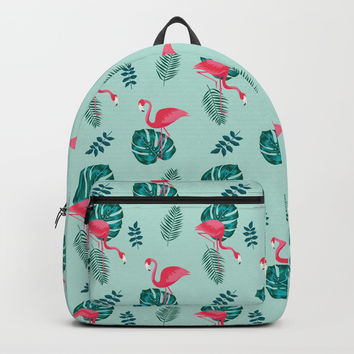 pink flamingo bird on blue and green tropical pattern Backpacks by Gal Ashkenazi