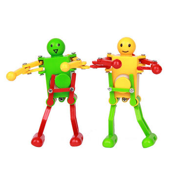 2PCS lot Clockwork Spring Wind Up Toy Dancing Robot Toy for Children Kids Toy Yellow Green Red