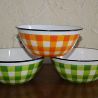 Vintage Lot of 3 1960s Graniteware Checkerboard Pattern Cereal Bowls One Orange Two Green White Background Black Trim