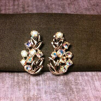 Silver tone Leafy A/B clear colored rhinestone clip screw back earrings.