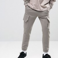 Puma Skinny Cargo Joggers in Gray Exclusive to ASOS at asos.com