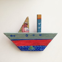 Sailor on wooden boat, folk art shabby boat of reclaimed wood, salvaged, old wood folk boat with Greek sailor painted, Greek folk art