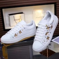 LV Louis Vuitton 2019 new metal rivet flower female models wild casual sports shoes white