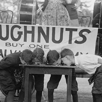 Boys Chow Down on a Table in a Donut Eating Contest (Fine Art Giclee)