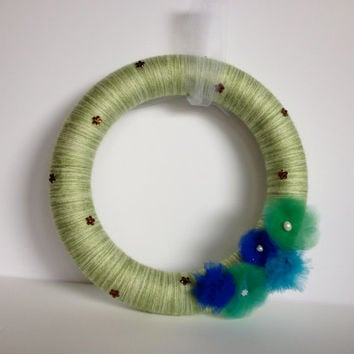 Green yarn wreath with green and blue tulle flowers- 12 inches