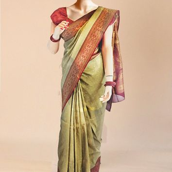the khaadi silk saree in dark tan and maroon with a rich coat of gold along border
