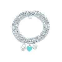 Tiffany & Co. - Return to Tiffany™ mini heart tags on sterling silver bead bracelets.