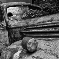 Abandoned Delivery Truck in Tall Weeds -- Black and white landscape photograph