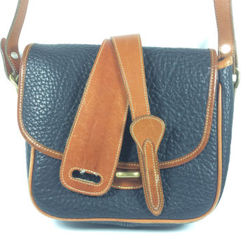 The Vintage Dooney & Bourke all leather long strap bag