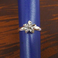 A tiny silver plated floral mult-task ring, above knuckle ring,adjustable finger ring,stackable ring, toe ring, little finger ring