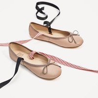 LEATHER BALLERINAS WITH INTERCHANGEABLE BOWS