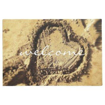 """Welcome"" heart drawn in golden sand photo doormat"
