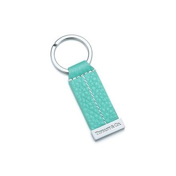 "Tiffany & Co. -  ""T"" stitch key ring in palladium-plated solid brass with Tiffany Blue® leather."