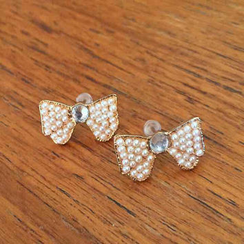 Gold pearl bow stud earrings