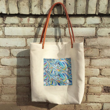 Hemp canvas tote with leather straps, ocean wave print pocket
