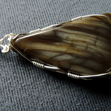 Petrified Wood free form pendant,sterling silver wire wrapped,with a stamped sterling silver plated snake chain necklace