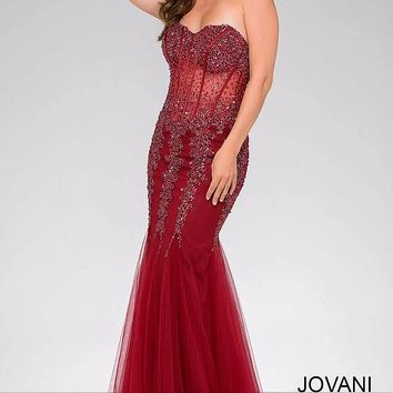 Burgundy strapless floor length mermaid gown with exposed piping.