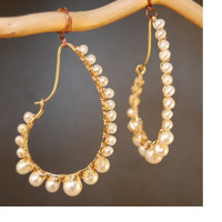 Hammered drops wrapped with ivory pearls Cosmopolitan 48