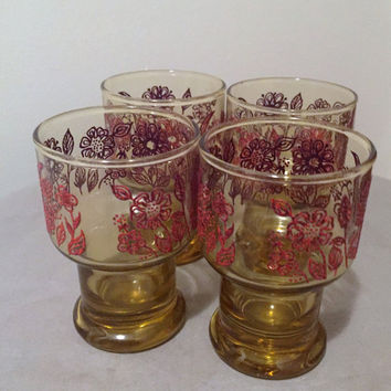 Set of Four (4) Vintage 1960s Amber Glass Tumblers with a red raised floral design