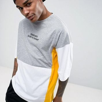 ASOS Oversized T-Shirt With Text Embroidery And Panels at asos.com