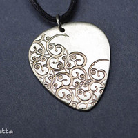 Curlicue nickel silver guitar pick jewelry