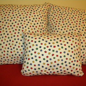 Lumbar Pillow Cover with ZIPPER CLOSURE Primary Colored Stars on a white background