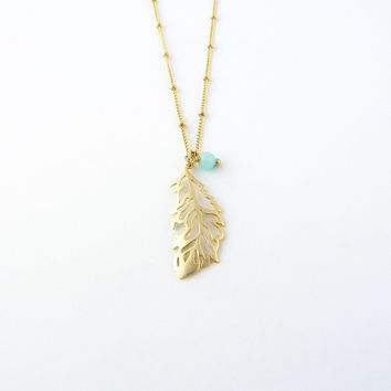 Feather necklace with blue bead charm | Gold layering necklace, Gemstone jewelry, Pendant necklace, Amazonite beaded necklace, Dainty chain